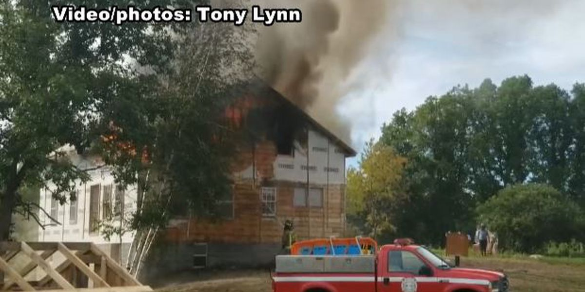 Firefighters battle blaze at home in Brasher Center