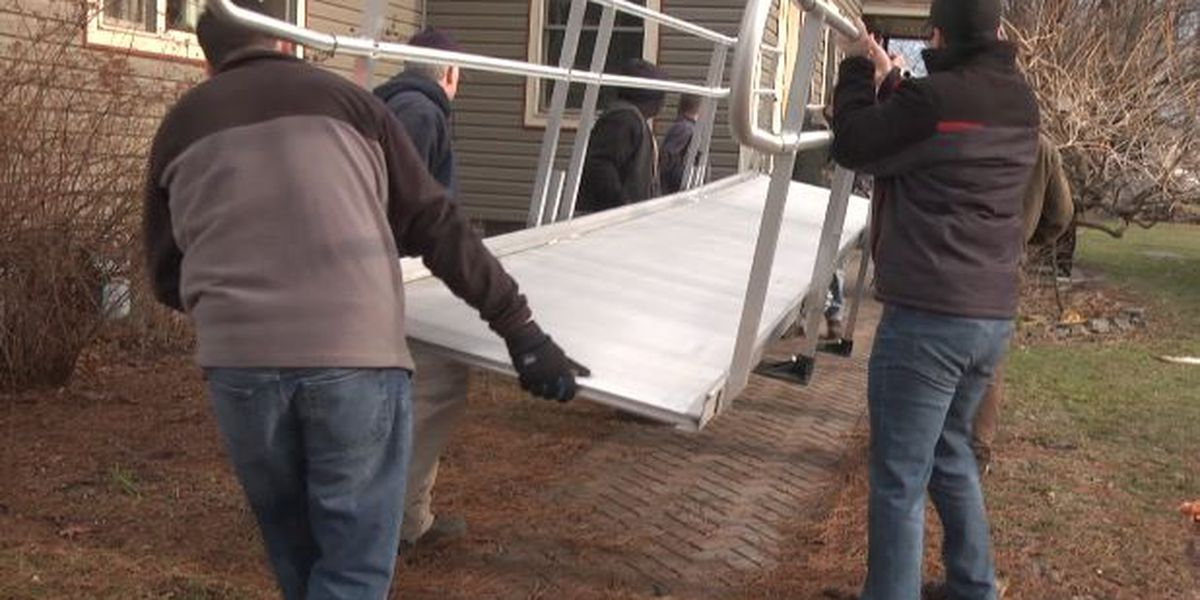 Volunteers install donated wheelchair ramp for injured deputy mayor