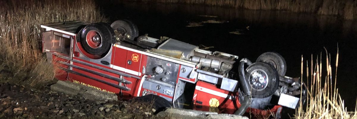 Fire truck overturns into Lake of the Isles
