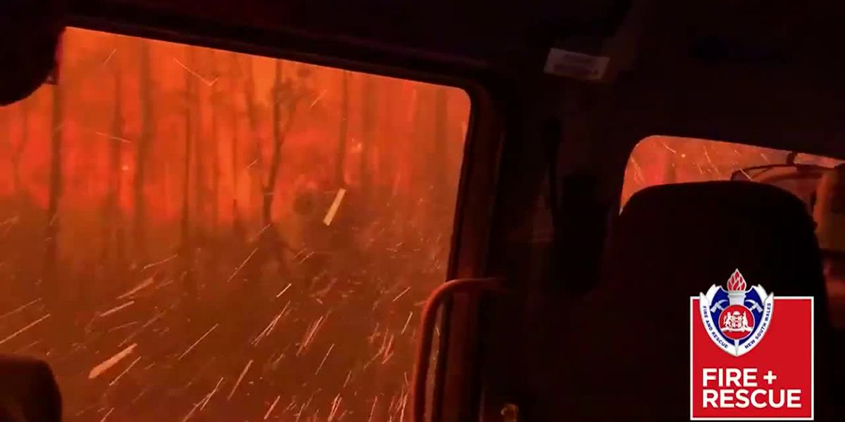 Australian firefighters drive through massive flames