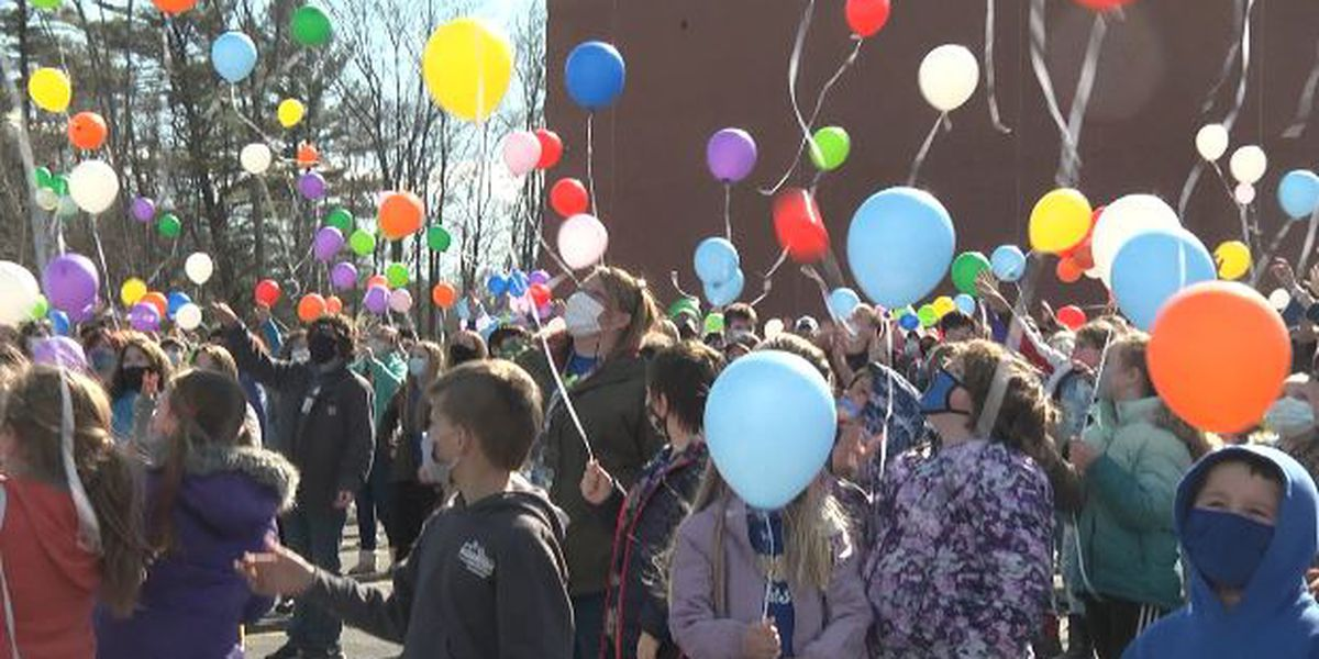 Students release balloons to mark COVID anniversary