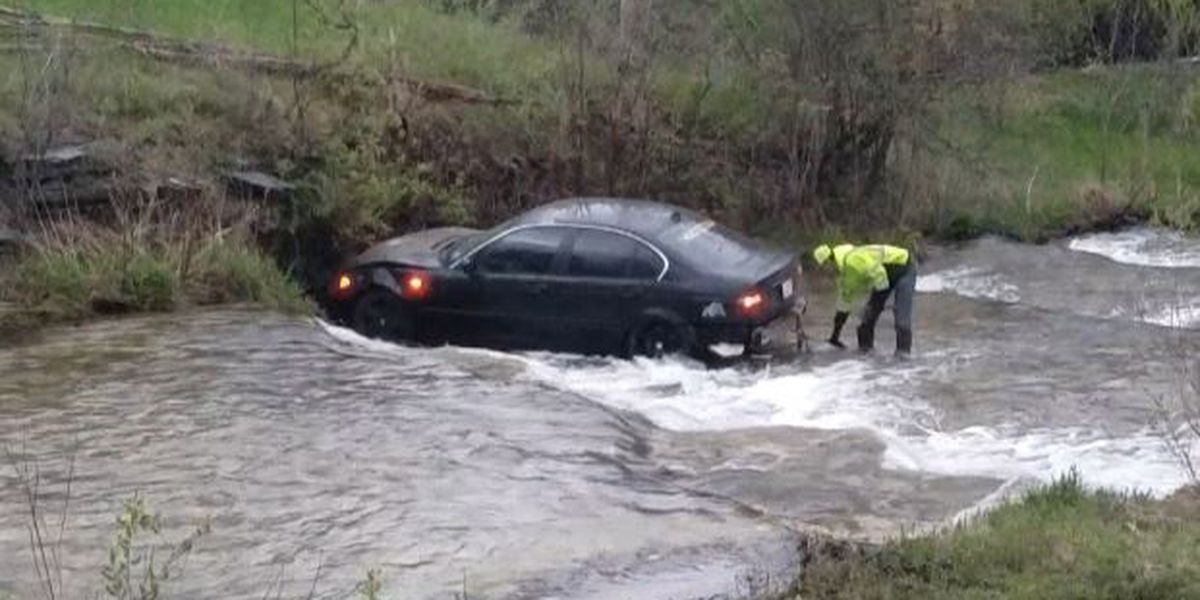 Police search for driver of BMW abandoned in creek