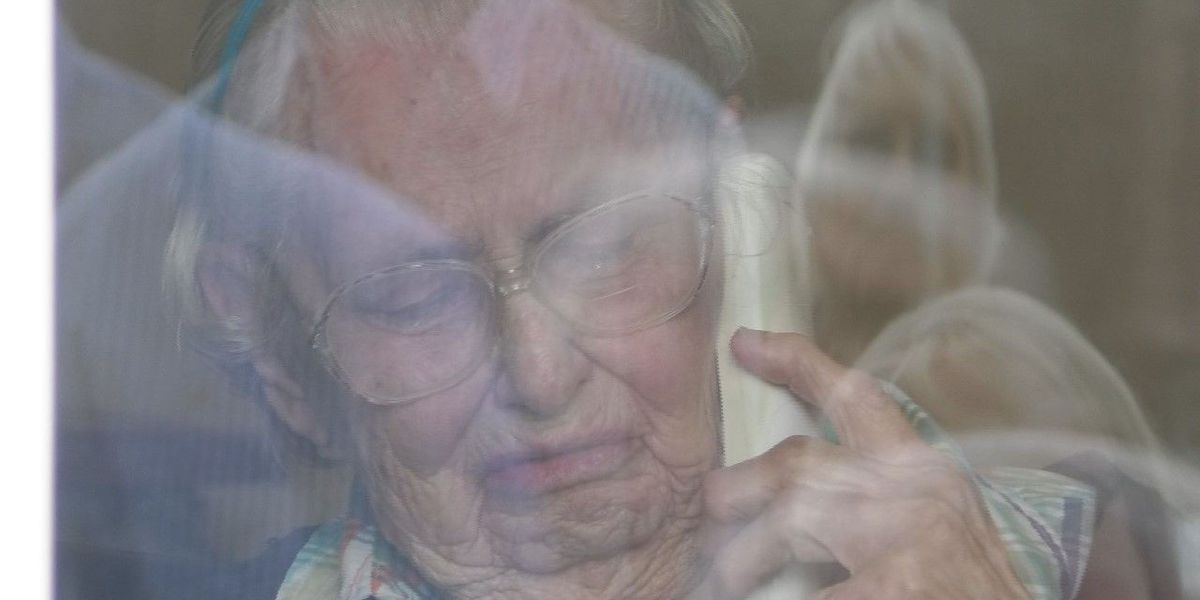 Woman cries tears of joy as family celebrates her 100th birthday outside home
