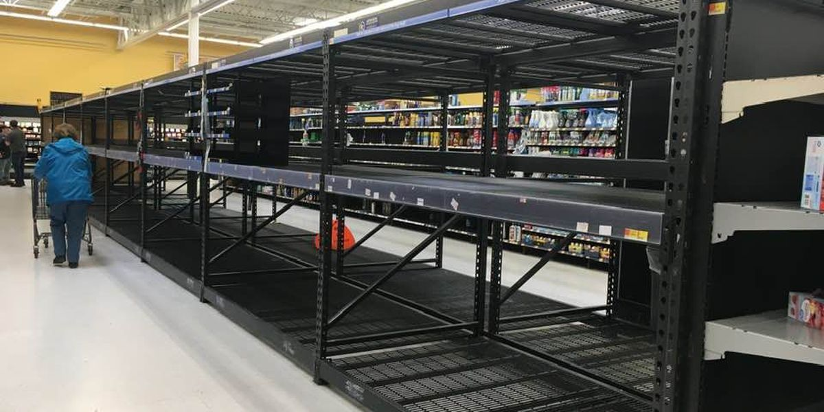 Grocery stores reassure shoppers as panic buying empties shelves