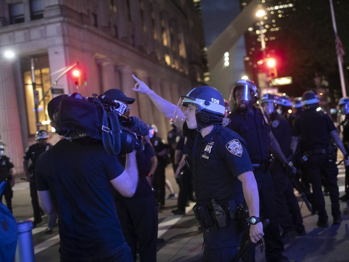 Police shove, make AP journalists stop covering protest