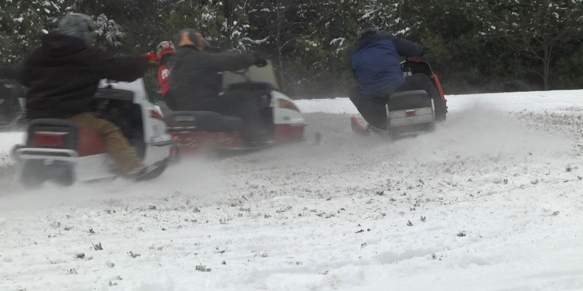 Vintage snowmobiling in Harrisville brings people in of all ages