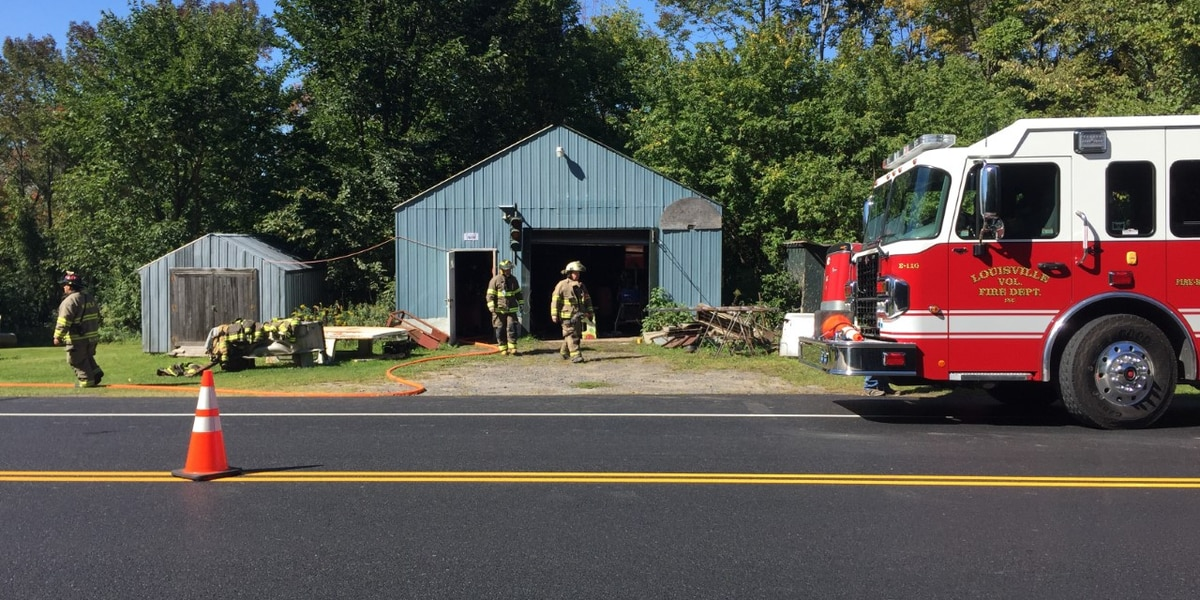A Norfolk garage fire sends a firefighter to the hospital with minor injuries