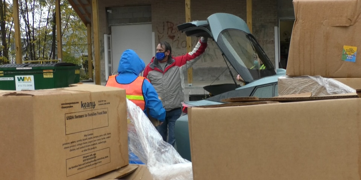CAPC distributes food, cars line up down the street