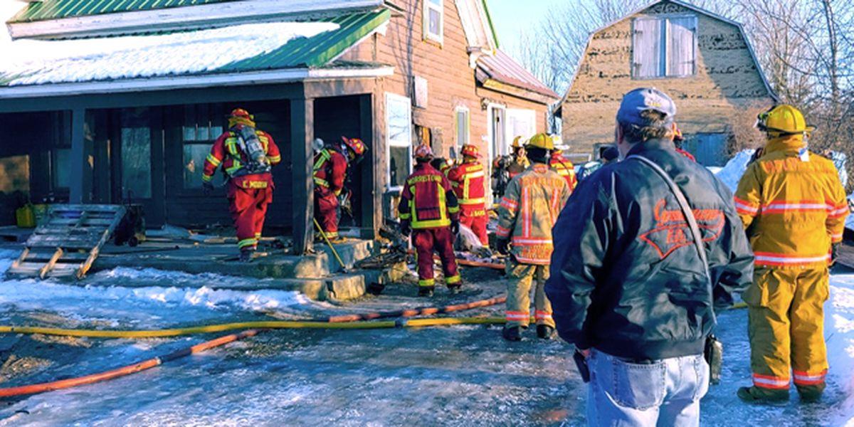 Volunteer firefighters save home