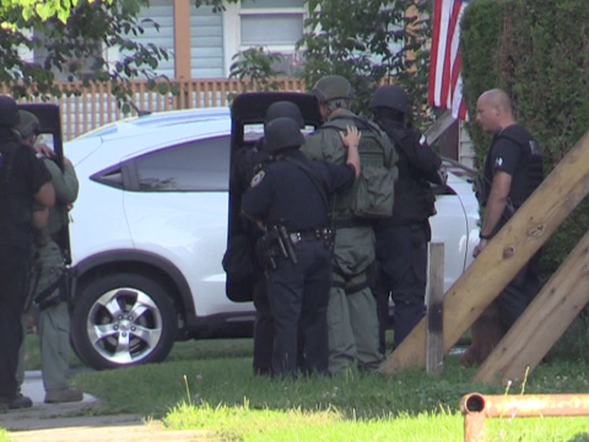 Update: man charged in Boyd Street stand-off